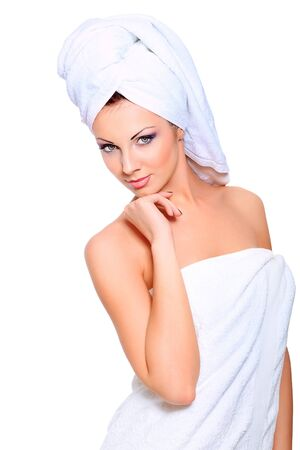 woman bathing: Beautiful young woman posing in white towel. Spa, healthcare. Isolated over white.
