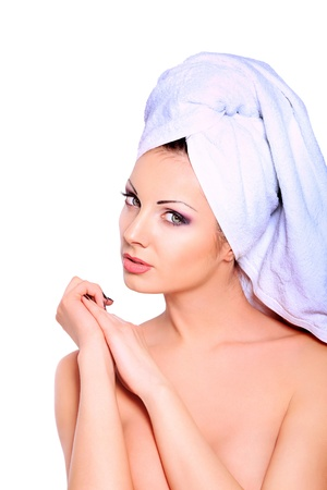 Beautiful young woman posing in white towel. Spa, healthcare. Isolated over white. photo