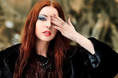 gothic woman: Shot of a gothic woman in a winter park. Fashion. Stock Photo