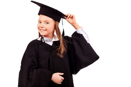 elementary students: Portrait of a cute girl in a graduation gown. Education. Isolated over white.
