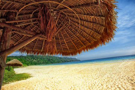 Tropical beach and umbrella on a beautiful island. Andaman Sea.  Stock Photo - 12846111