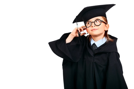 Portrait of a cute boy in a graduation gown. Education. Isolated over white. Stock Photo - 12845963