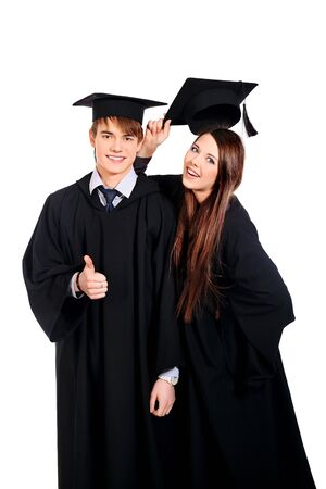 college graduation: Portrait of two happy graduating students. Isolated over white background.