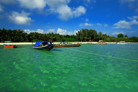 Picturesque tropical beach, traditional long tail boats, Andaman Sea. Stock Photo - 12846686