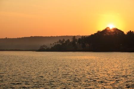 Picturesque landscape - sunset at a tropical beach. photo
