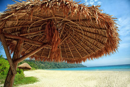 Tropical beach and umbrella on a beautiful island. Andaman Sea. Stock Photo - 12846675