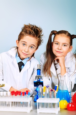 Two children making science experiments. Education. Stock Photo - 12846750