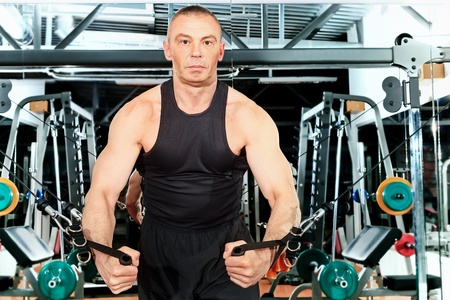 Mature sporty man in the gym centre. photo