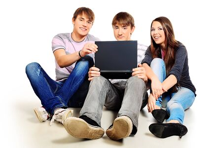 Group of young people with a laptop. Isolated over white background.  photo