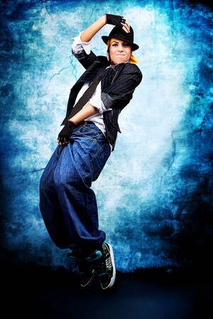 Modern woman dancing at studio.   photo