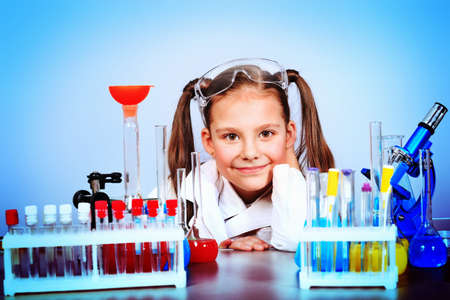 Little girl is making science experiments. Education. photo