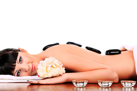 stone volcanic stones: Beautiful woman relaxing in a spa salon. Isolated over white.