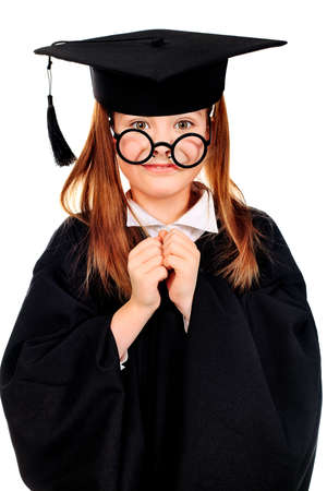 Portrait of a funny girl in a graduation gown. Education. Isolated over white. photo