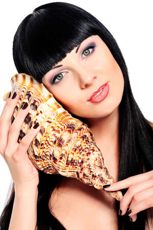 Beautiful young woman posing with marine shell. Spa, healthcare. Isolated over white. Stock Photo - 13291954