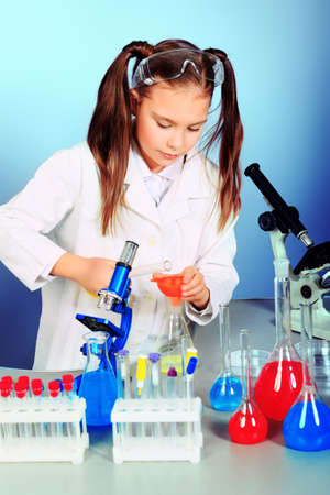 science experiments: Little girl is making science experiments. Education.