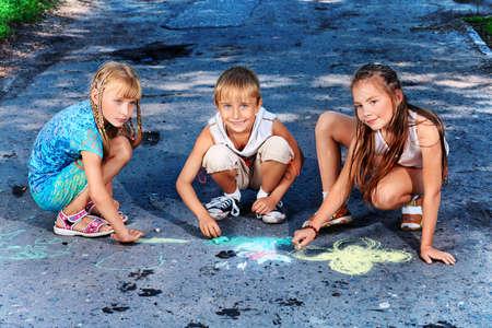 Happy children having fun outdoors. photo