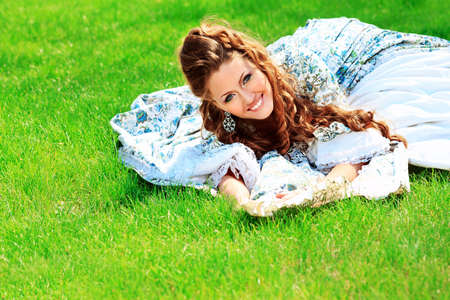 Beautiful young woman in medieval era dress on a sunny day outdoor. Stock Photo - 13292005