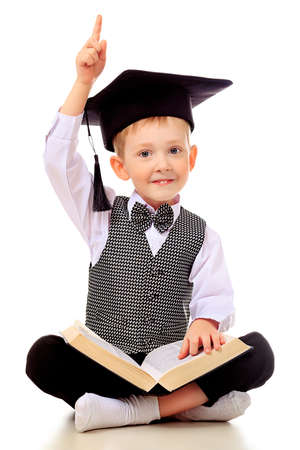 smart boy: Portrait of a little boy with a book. Isolated over white background.