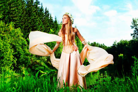 Portrait of a dreamy fairy girl outdoor. photo