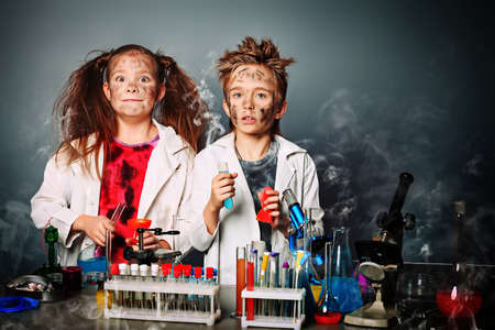experiments: Two children making science experiments. Education.