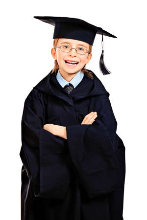 Portrait of a cute boy in a graduation gown. Education. Isolated over white. Stock Photo - 13368146