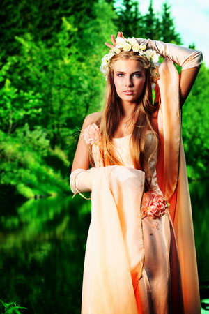 Portrait of a dreamy fairy girl outdoor. Stock Photo - 13368122