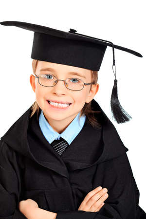 Portrait of a cute boy in a graduation gown. Education. Isolated over white. Stock Photo - 13442684