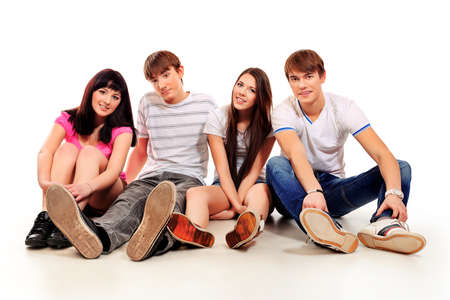 Group of happy young people isolated over white background.  photo