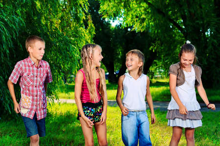 Group of cheerful children in a summer park. Stock Photo - 13546498