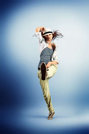 hip hop girl: Teenage girl dancing hip-hop at studio.