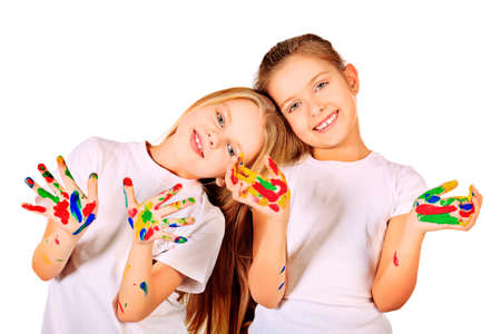face paint: Portrait of two cute girls enjoying painting. Education. Isolated over white background.