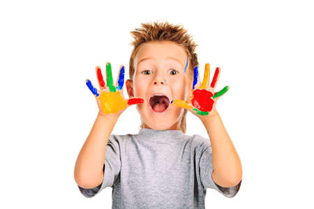 children painting: Portrait of an emotional boy enjoying his painting. Education. Isolated over white background.