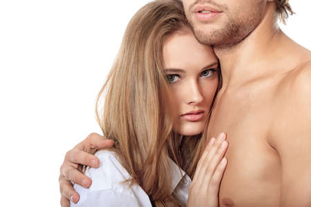 erotic couple: Shot of a passionate young people in love. Isolated over white. Stock Photo