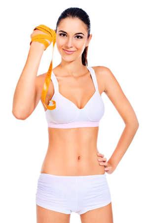cintura perfecta: Mujer delgada medir su cintura. Dieta, estilo de vida saludable.