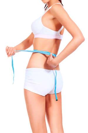 diet woman: Slender woman measuring her waist. Diet, healthy lifestyle. Stock Photo
