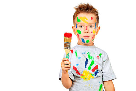 hobby: Portrait of a little boy enjoying his painting. Education. Isolated over white background. Stock Photo