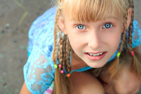 Portrait of a smiling little girl outdoors. photo