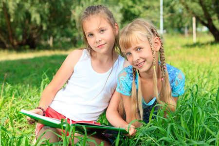 Two cheerful girls having fun outdoors. photo