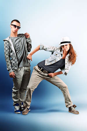A couple of young man and woman dancing hip-hop at studio. photo