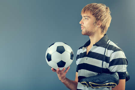 Portrait of a handsome soccer player. Studio shot. photo