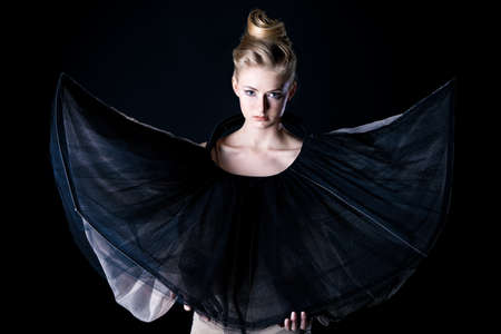 Art fashion photo of a beautiful model  Over black background