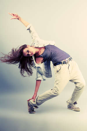 Teenage girl dancing hip-hop at studio. photo