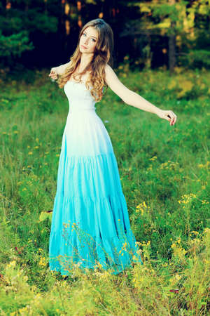 Romantic young woman posing outdoor. Stock Photo