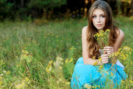 country girl: Romantic young woman posing outdoor. Stock Photo