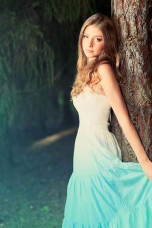 country lifestyle: Romantic young woman posing outdoor. Stock Photo