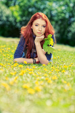 Romantic young woman  outdoors at a summer day. photo