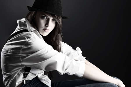 Shot of an attractive fashionable girl posing in studio Stock Photo - 13877015
