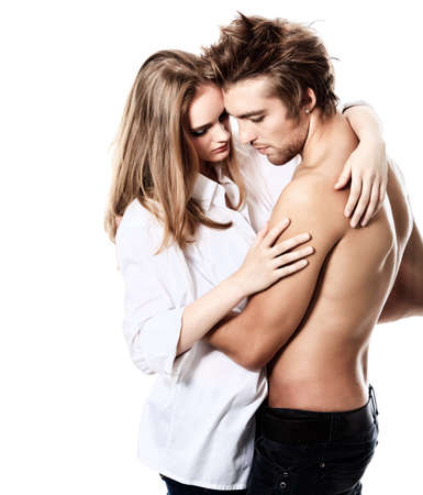 Shot of a passionate young people in love. Isolated over white. Stock Photo