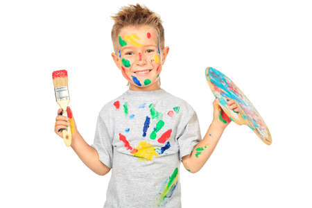 children painting: Portrait of a little boy enjoying his painting. Education. Isolated over white background. Stock Photo