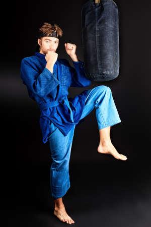 Martial arts fighter posing at studio. photo